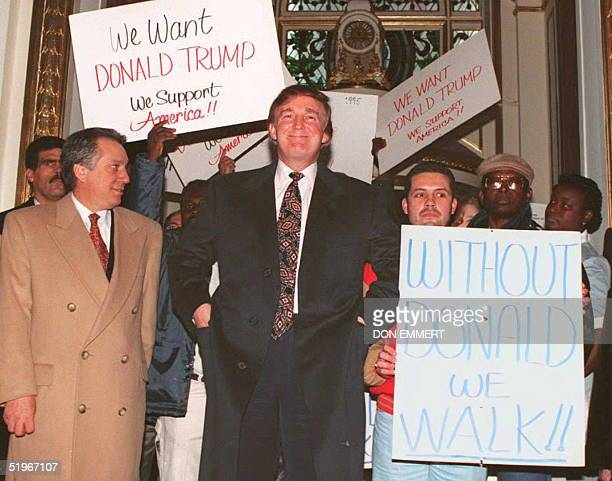 US business tycoon Donald Trump enters the PLaza Hotel in New York past supporters 21 December 1994 Hundreds of supporters showed up at a news...