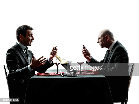 business using smartphones dinner silhouettes : Stock Photo