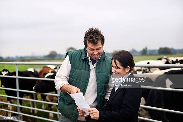business woman advising farmer