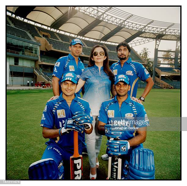 Business woman and founder/chairperson of Dhirubhai Ambani International School Nita Ambani is photographed with players from the Mumbai Indians a...