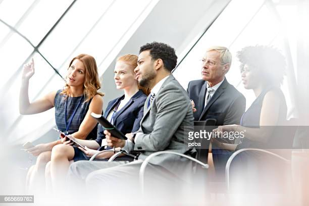 business woman  asking question in seminar