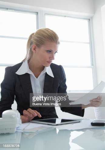 Business woman at her desk with tablet : Stock Photo
