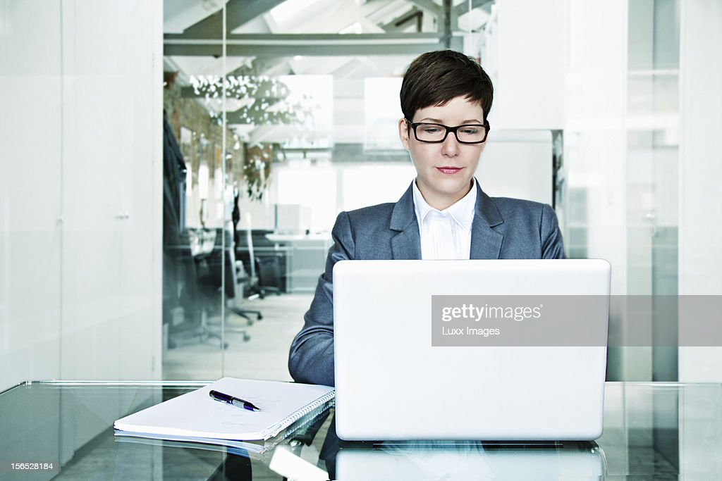 Business woman at laptop at office : Stock Photo