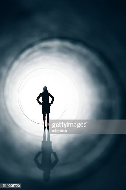 Business Woman At Light At The End Of The Tunnel