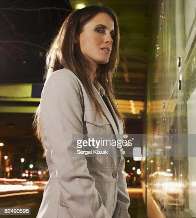 Business woman at night on urban street