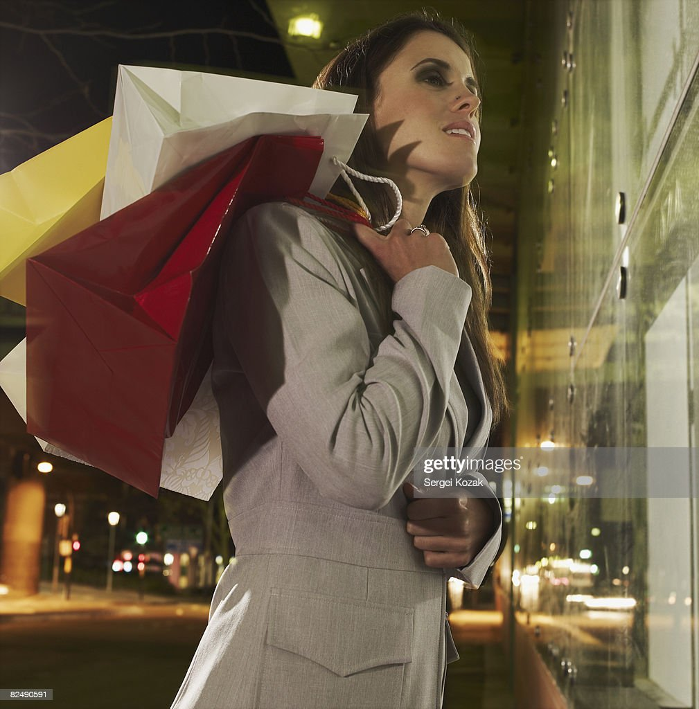 Business woman at night window shopping  : Stock Photo