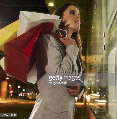 Business woman at night window shopping  : Stock Photo