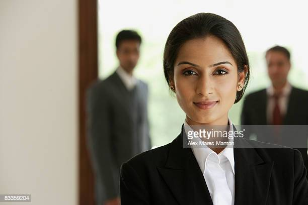 business woman, businessmen in background