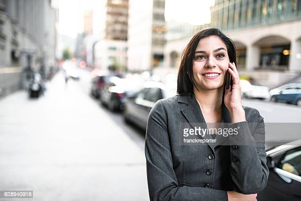 business woman calling on the phone - urban scene