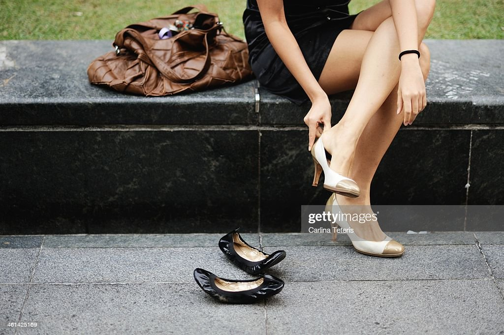 Business woman changing her shoes