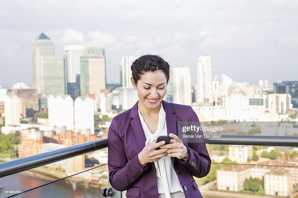Business woman checking mobile phone. : Stock Photo