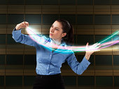 Business woman controlling light trails