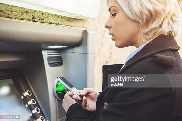 Business woman credit card withdrawal at bank