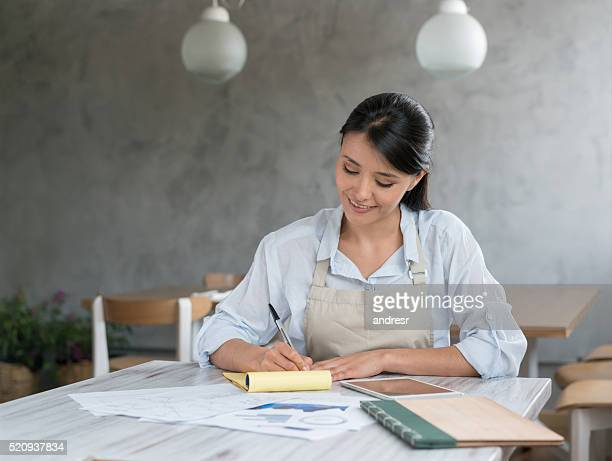 Business woman doing the books at a restaurant