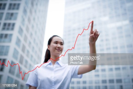 Business Woman Drawing a Growth Chart - XXXLarge