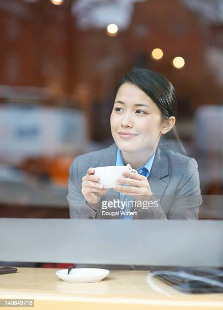 Business woman drinking in cafe.