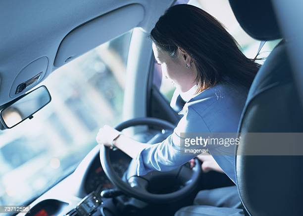 Business woman driving a car