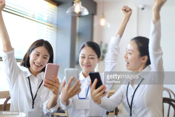 business woman enjoying while watching a smartphone