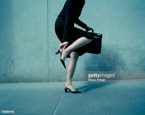 Business Woman Fixing Shoe