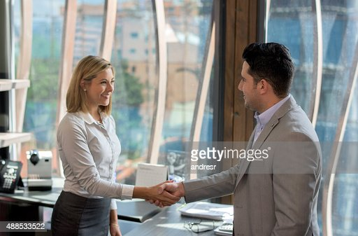 Business woman greeting a client