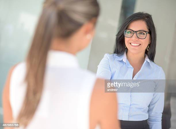 Business woman greeting with a handshake