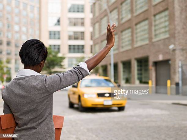 Business woman hailing taxi