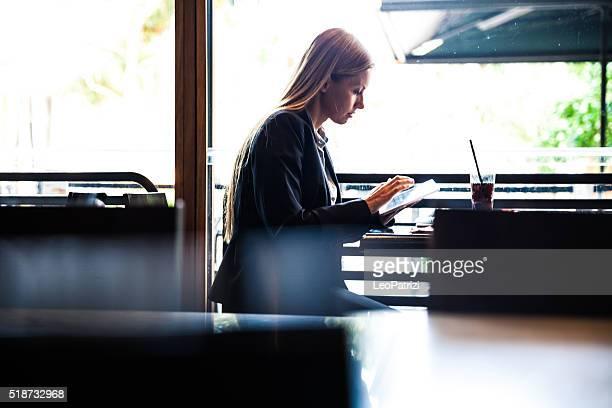 Business woman having a break in a restaurant