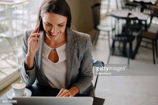 Business woman having coffee and checking mailbox
