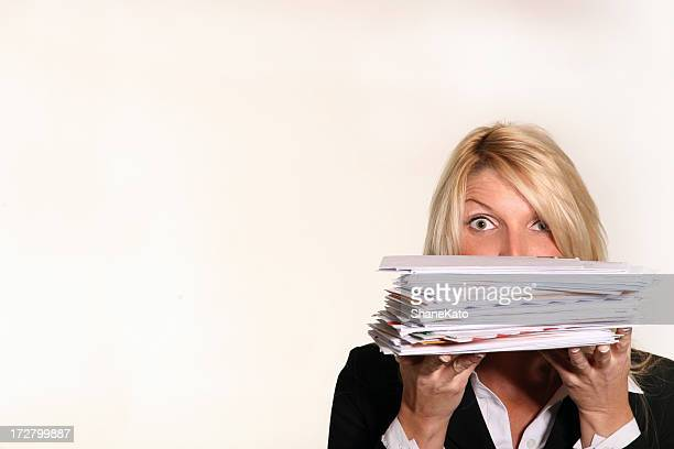 Business woman hold stack of Junk Mail and unpaid bills