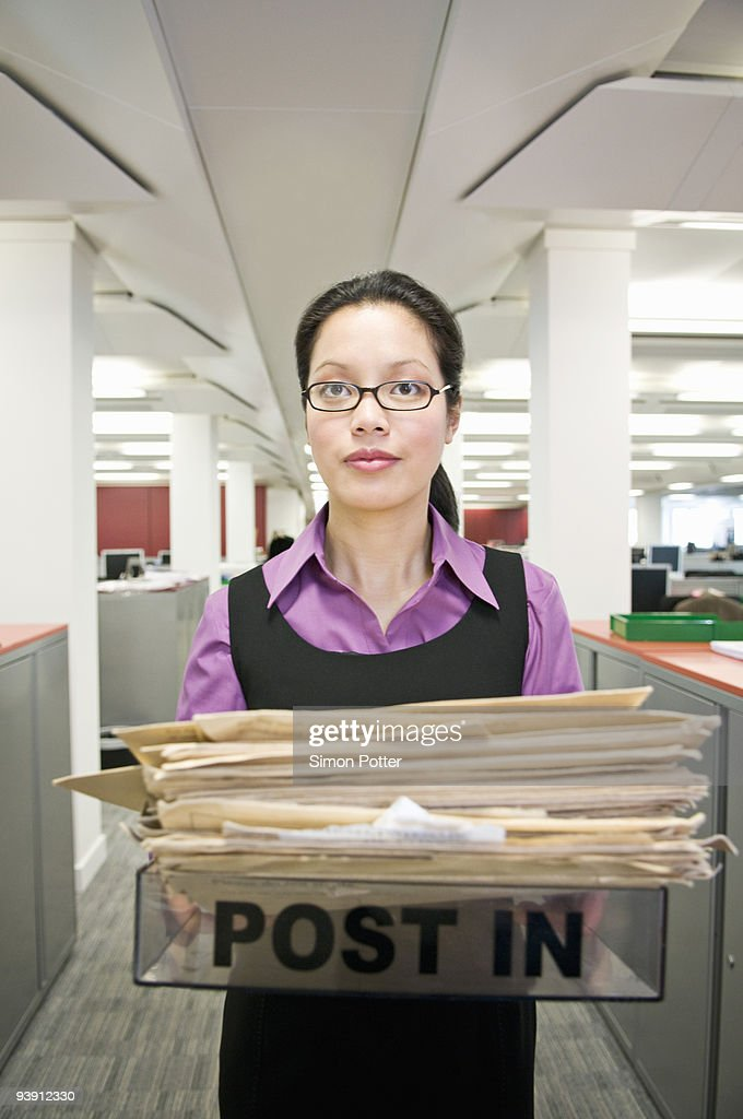 Business woman holding a 'post in' tray : Stock Photo