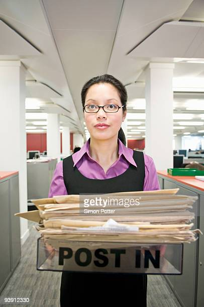 Business woman holding a 'post in' tray