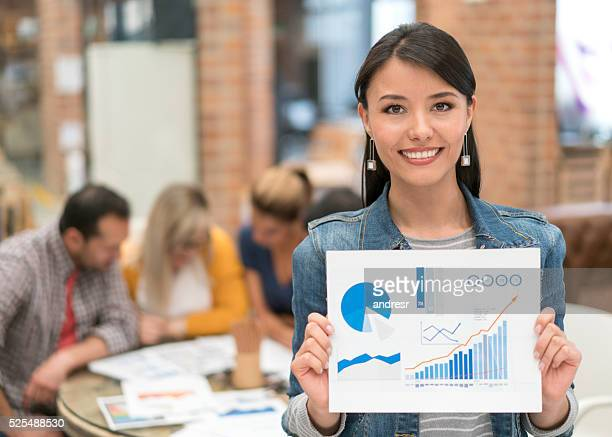 Business woman holding document at the office