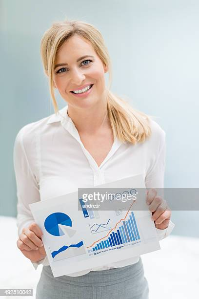 Business woman holding document with statistics