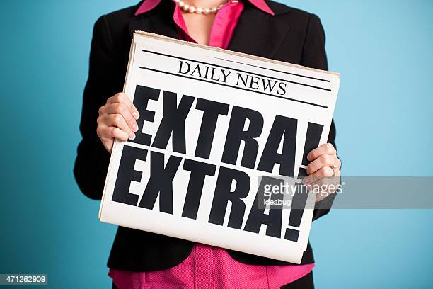 Business Woman Holding Newspaper with Extra! Headline