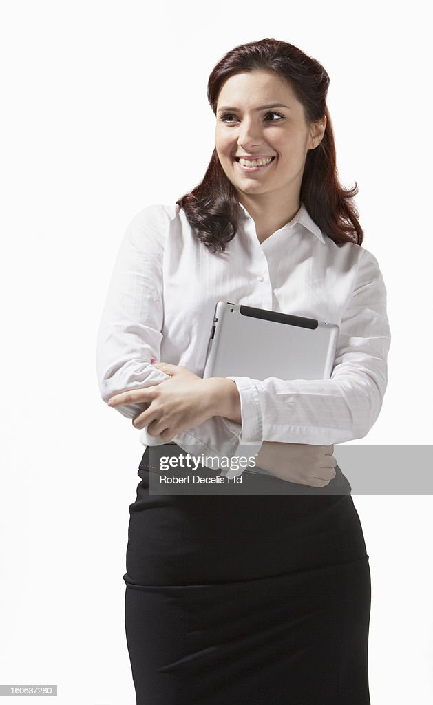 Business woman holding tablet smiling : Stock Photo