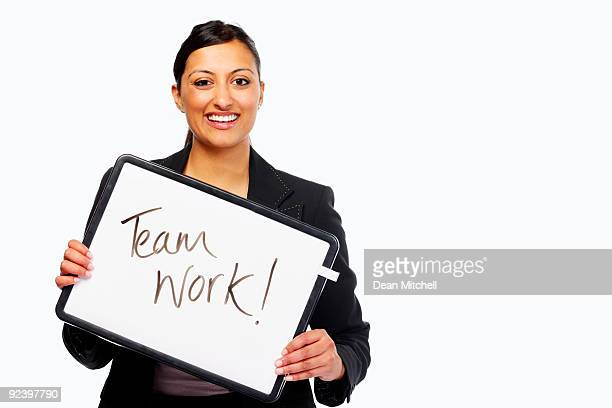Business woman holding team work sign over white background