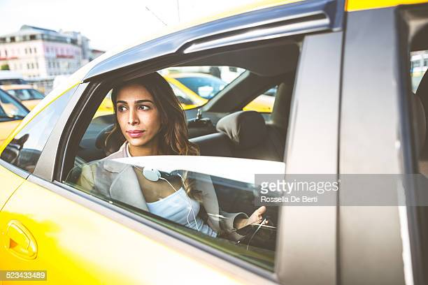 Business Woman In A Taxi