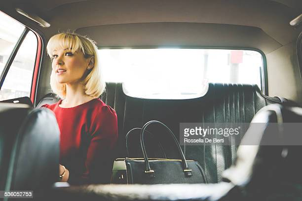 Business Woman In A Taxi Talking To The Driver