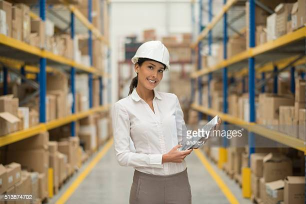 Business woman in a warehouse