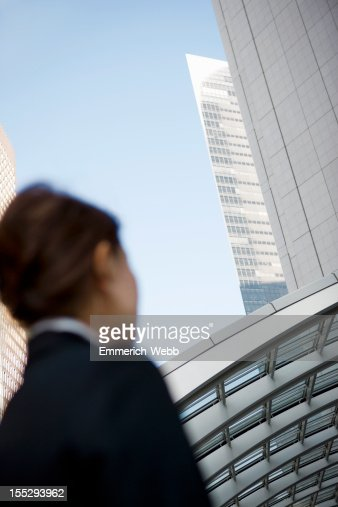 Business woman in business district : Stock Photo