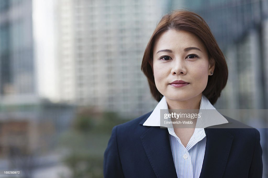Business Woman in city with modern buildings : Stock Photo