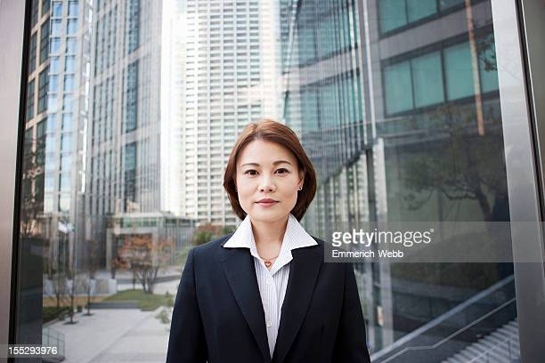 Business Woman in city with modern buildings