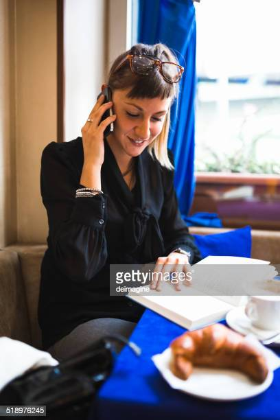 Business woman in coffee bar