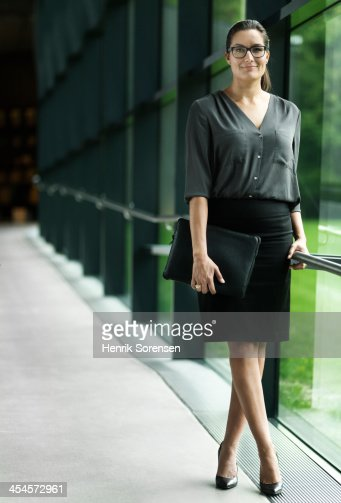 Business woman in hallway : Stock Photo