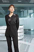 Business woman in office building portrait