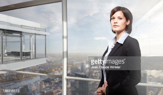 Business woman in office looking into camera : Stock Photo