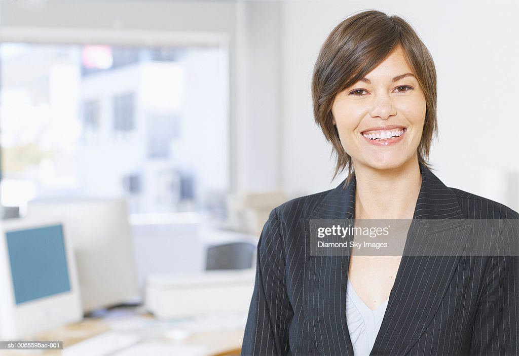 Business woman in office, portrait : Stock Photo