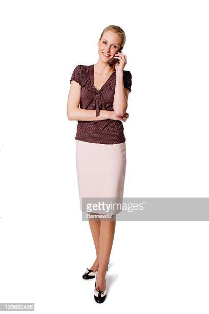 Business woman in skirt and blouse.