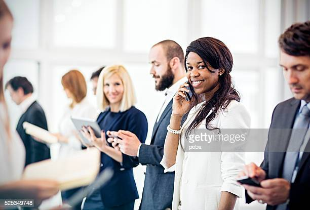 business woman   in  the office using mobile phone