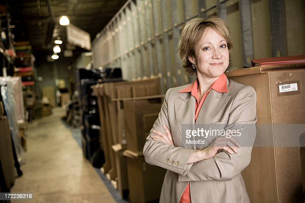 Business woman in warehouse